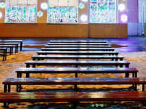 Melting snow, christmas lights, wet wooden benches. In winter night royalty free stock images