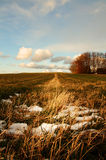 Melting snow in countryside Stock Photo