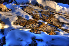 Melting snow on hillside Stock Photography