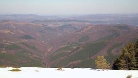 Melting snow scenery in the mountains. Spring time in Beklemeto, Stara planina, Bulgaria stock footage
