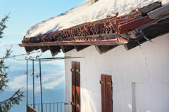 Melting snow on the tile roof. Stock Photo