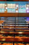 Melting snow, xmas illumination, wet benches Stock Photos