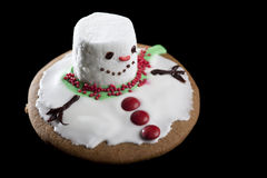 Melting Snowman Cookie. Horizontal image of a cookie, made to look like a melting snowman Stock Photography
