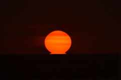 Melting sun. A beautiful view of a sunset in a beach of Ecuador, Canoa Stock Photo