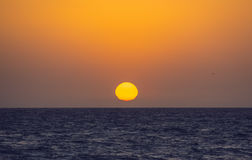 Melting Sun in water of sea. Water Stock Image
