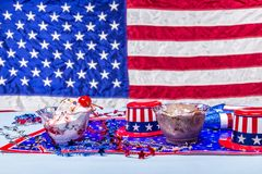 Melting vanilla and chocolate ice cream patriotic background Royalty Free Stock Photo