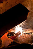 Melting welding electrode with spark. At welder work Stock Photography
