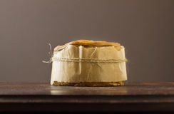 Melton Mowbray pork pie with wrapper Stock Photo