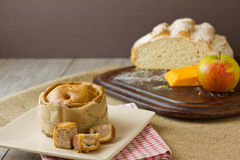 Melton Mowbray pork wrapped with ploughmans lunch. An English artisan Melton Mowbray pork pie, wrapped with brown paper and twine with boule bread, red leicester Royalty Free Stock Photos