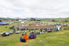 Crowds watching rural Rodeo. Melton Mowbray, Tasmania-November 1, 2003. Crowds watching the annual Melton Mowbray rodeo, set up in a paddock, Tasmania, Australia Stock Image