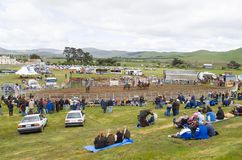 Crowds watching rural Rodeo. Melton Mowbray, Tasmania-November 1, 2003. Crowds watching the annual Melton Mowbray rodeo, set up in a paddock, Tasmania, Australia Royalty Free Stock Photos