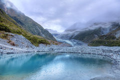 Meltwater pool at Fox Glacier Stock Photo