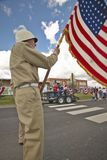 Member of a color guard carrying an American flag, in Lima Montana Stock Photos