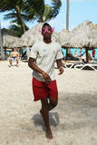 Member of  Majestic Elegance Punta Cana entertainment team on the beach Royalty Free Stock Images