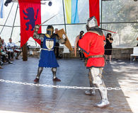 Member Member of the annual festival of Knights of Jerusalem dressed as knights, are fighting with swords on the ring Royalty Free Stock Images