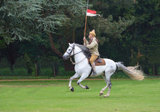 A member of the Punjab Lancers in World War One uniform riding a white horse. Stock Photography