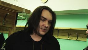 Member rock band Kukryniksy Alex Gorshenev give interview at backstage to man in leather jacket. Nightclub stock video footage