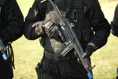 Member of special forces. SWAT team member with machine gun Stock Photos
