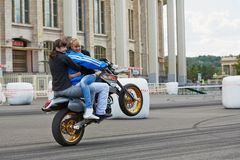 Member from stuntmen team rides motorcycle Stock Photos
