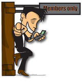 Members only. A body guard out side a privet club using his mobile Royalty Free Stock Images