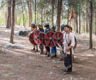 Members of the annual reconstruction of the life of the Vikings - `Viking Village` demonstrate combat formation in the forest near. Ben Shemen, Israel, November Stock Photography