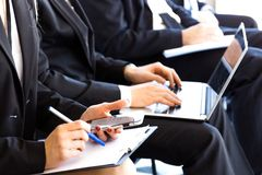 Business audience at training. Members of audience of business training writing notes royalty free stock photo