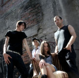 Members of the band. Photo shot of band members posing in an alley Stock Images