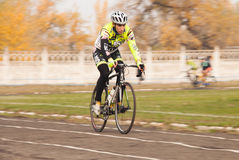 Members of bicycle race competition passing last kilometers in race Stock Image