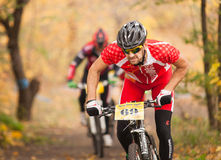 Members of bicycle race competition passing last kilometers in race Royalty Free Stock Photo