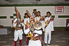 Members of a brass band show their repertoire to the audience in Stock Photography