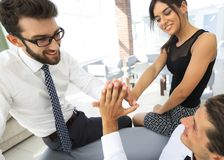 Members of the business team give each other high five. The concept of success.photo with copy space Stock Image