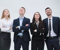 Successful business team looking up. Members of the business team standing close by and looking up Royalty Free Stock Photography