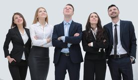 Successful business team looking up. Members of the business team standing close by and looking up Stock Photos