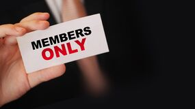 MEMBERS ONLY on a card Businessman holds. VIP clients in business concept