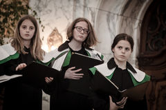 Members of child Choir sing at the St. Michael Church Stock Photos