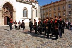 Members of the Cravat Regiment. CROATIA ZAGREB, 1 OCTOBER 2017: Changing of the guard, Members of the Cravat Regiment in front of the Church of St. Mark, Zagreb Royalty Free Stock Photo