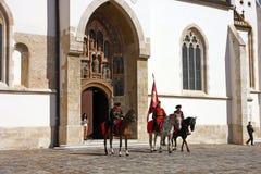 Members of the Cravat Regiment. CROATIA ZAGREB, 1 OCTOBER 2017: Changing of the guard, Members of the Cravat Regiment in front of the Church of St. Mark, Zagreb Stock Photography