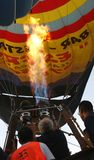 Hot air ballon burner heater vertical. Members of the crew of a hot air ballon inflating the ballon before a demostration flight airshow in Palma de Mallorca stock photo