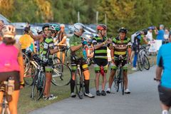 Members of a cycling club talk before their ride, editorial. royalty free stock images