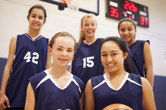 Members Of Female High School Basketball Team. Looking At Camera Smiling Royalty Free Stock Image
