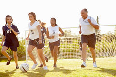 Members Of Female High School Soccer Playing Match Royalty Free Stock Images