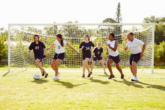 Members Of Female High School Soccer Playing Match Stock Photography