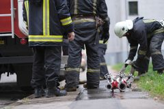 Members of the fire brigade store the equipment Stock Images