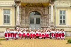 Members of folk group Tashe Miloshevski , posing in yard of a well known building Saray in Macedoni Stock Photo