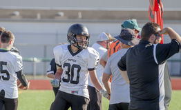 High school football team and referee Royalty Free Stock Photos