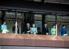 Members of the imperial family on the balcony of the palace are greeted by the people in the square in Tokyo. New years day. members of the family of the Stock Photos