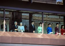 Members of the imperial family on the balcony of the palace are greeted by the people in the square in Tokyo. New years day. members of the family of the Royalty Free Stock Images