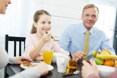 Members of Lovely Family Having Breakfast Royalty Free Stock Photos