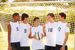Members Of Male High School Soccer Team. Looking At Each Other Smiling Stock Photos