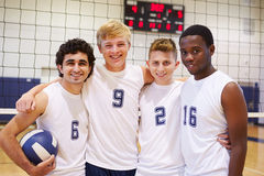 Members Of Male High School Volleyball Team. Smiling To Camera With Arms Around Each Other Stock Image